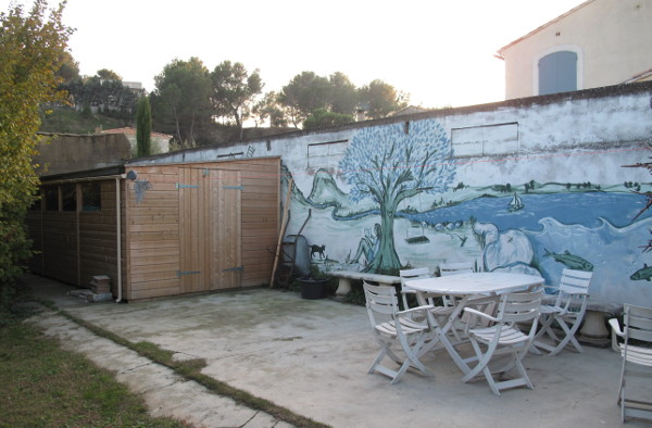 Back of garden with mural, garden shed and pool